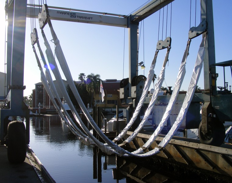 Sling shield protects vessel finishes from boat lift for Outboard motor lifting strap