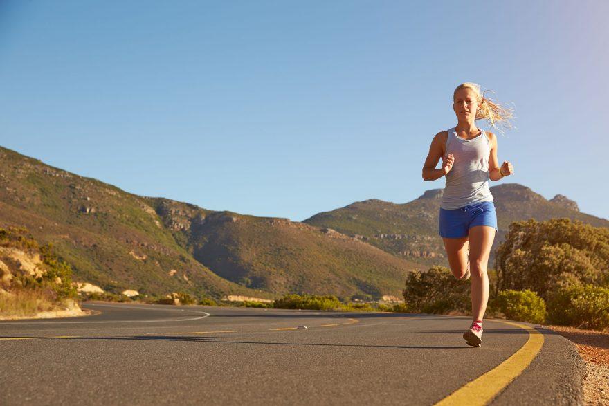 woman road running