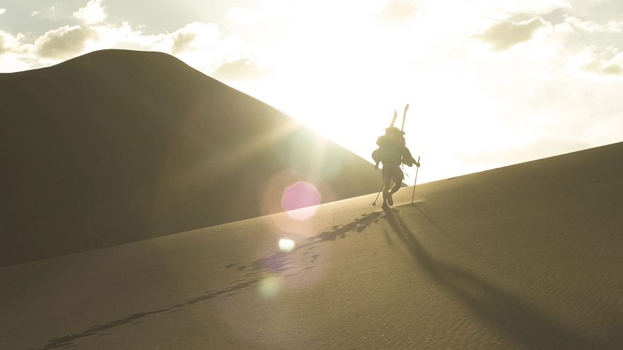 Wade-Holland-hiking-to-the-top-of-Star-Dune